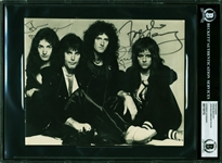 "Queen Rare Group Signed 6.75"" x 8.5"" Black & White Photo w/ Mercury, Deacon & Taylor (Beckett/BAS Encapsulated)"